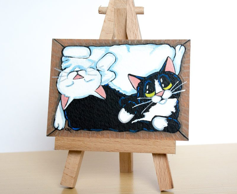 A box of Yin and Yang Cat ACEO by Lisa Marie Robinson
